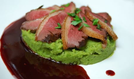 seared duck breast with fresh fava puree and red currant sauce