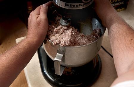 mixing venison sausages