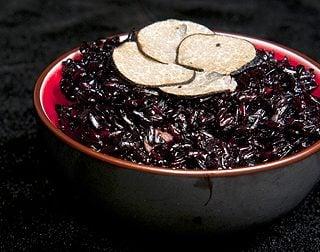Italian black rice with black trumpet mushrooms
