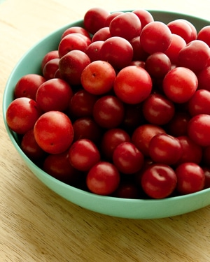 bowl of red wild plums
