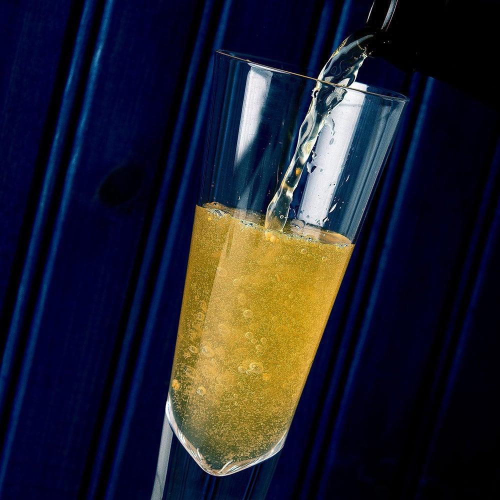 pouring elderflower champagne