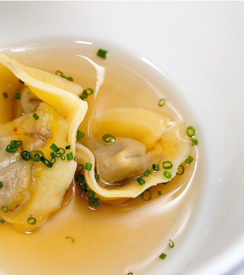 duck liver ravioli in a light broth