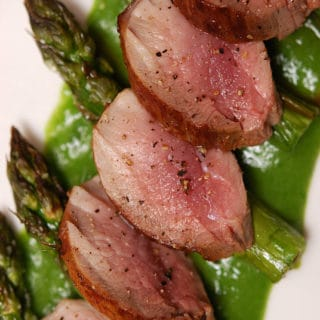 Pork loin with asparagus on a plate