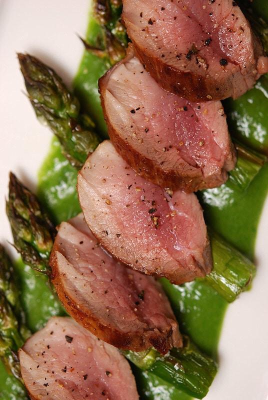 Pork loin with asparagus on a plate