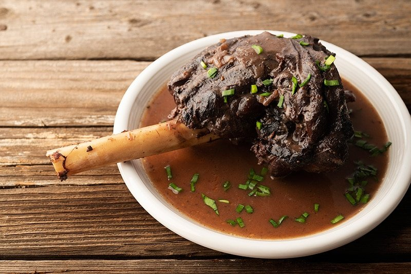 Portuguese braised venison shanks on a plate
