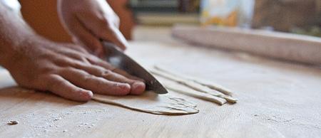 cutting pici dough
