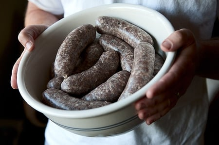 A bowl of venison sausages
