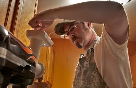 Hank Shaw grinding venison