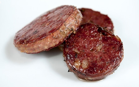 seared medallions of goose neck sausages