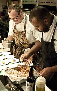 Hank Shaw and Dennis Sydnor plating food