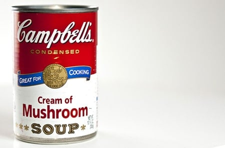 A can of cream of mushroom soup