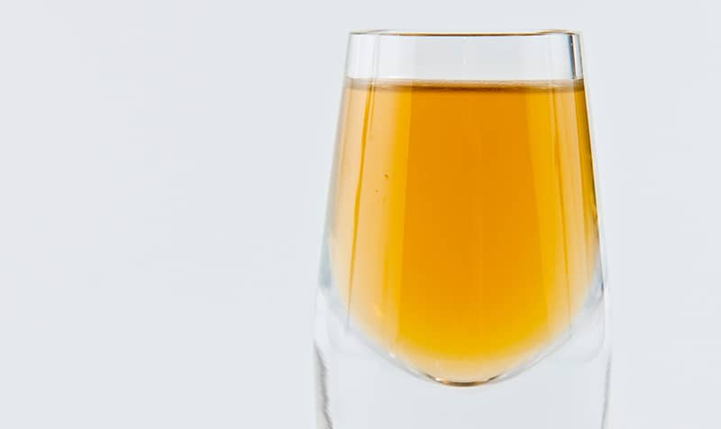 A glass of consomme.