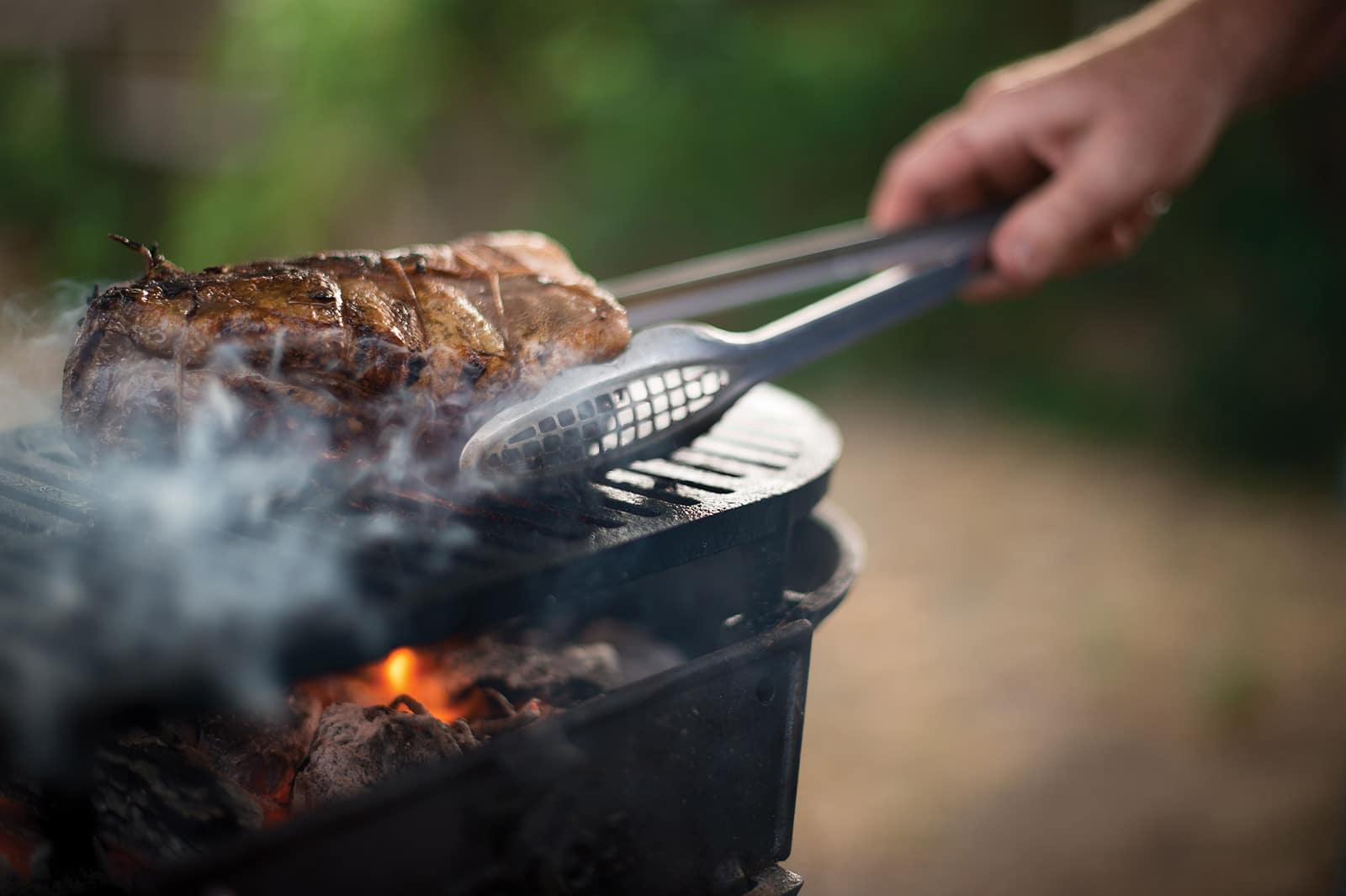 Grilling a venison loin on a hibachi