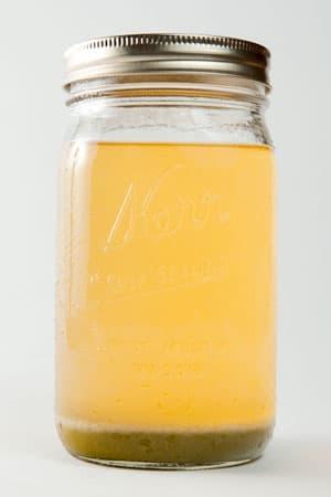 verjus in jar with sediment settling