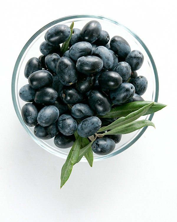 Fresh black olives in a bowl ready to be oil cured