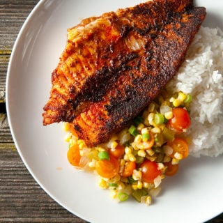 Blackened catfish with relish and rice