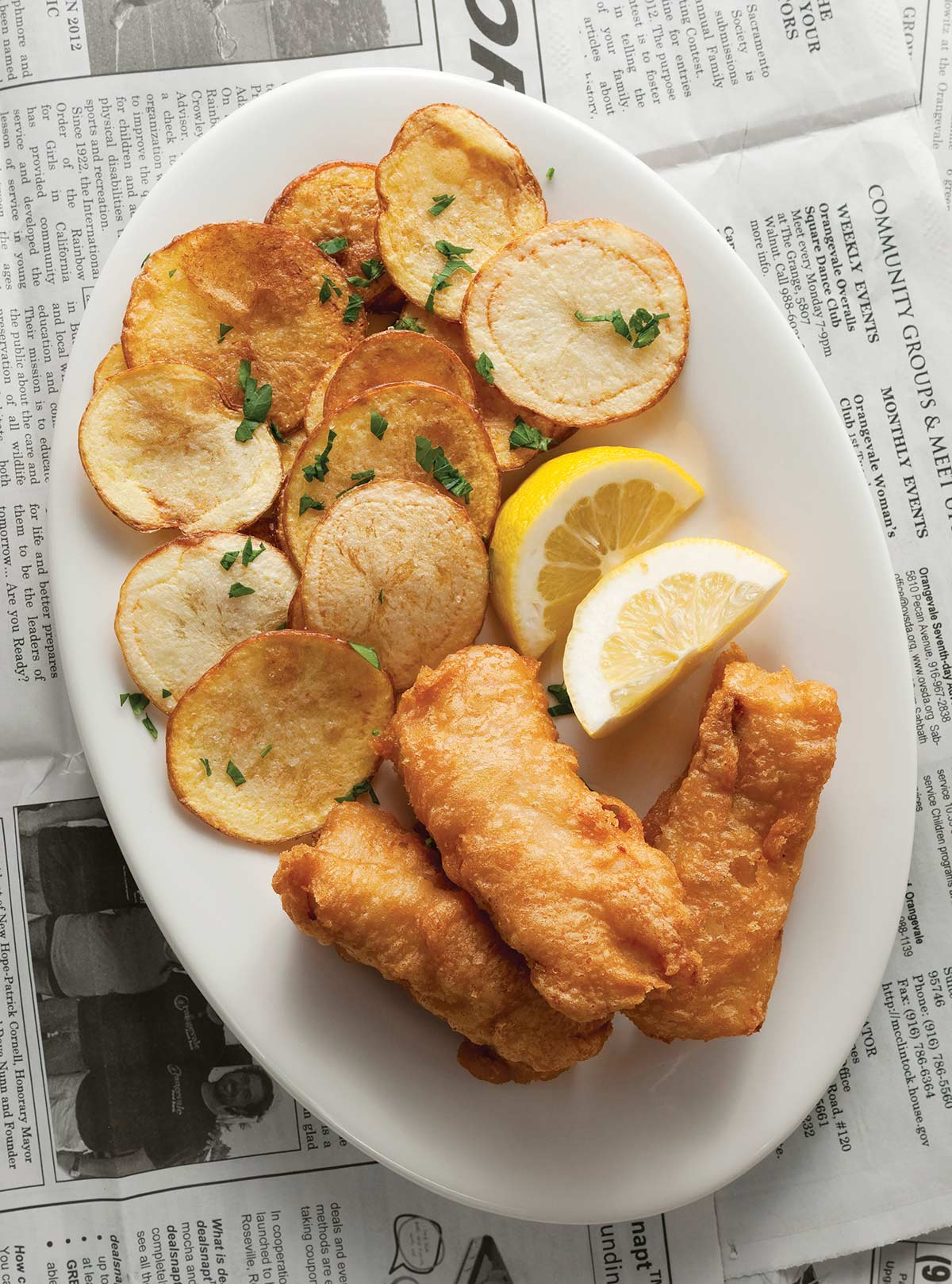 A plate of beer battered fish and chips