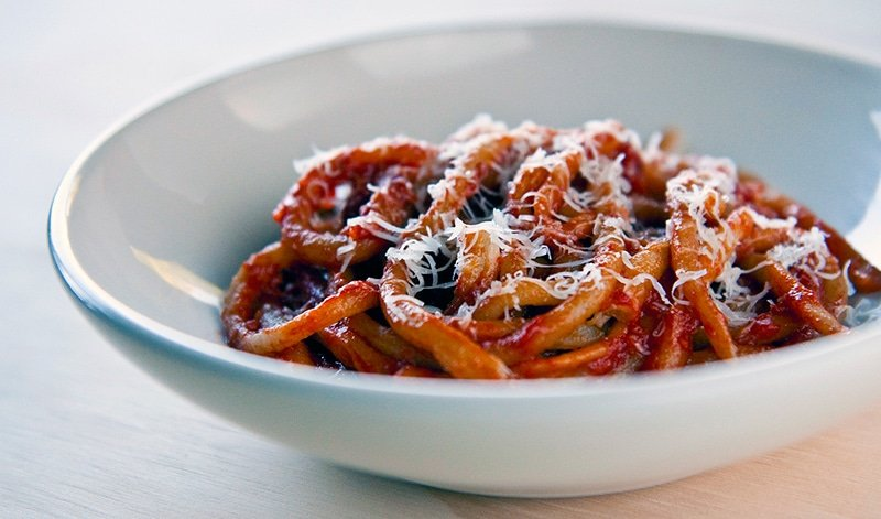 Homemade pici pasta with tomato-fennel sauce