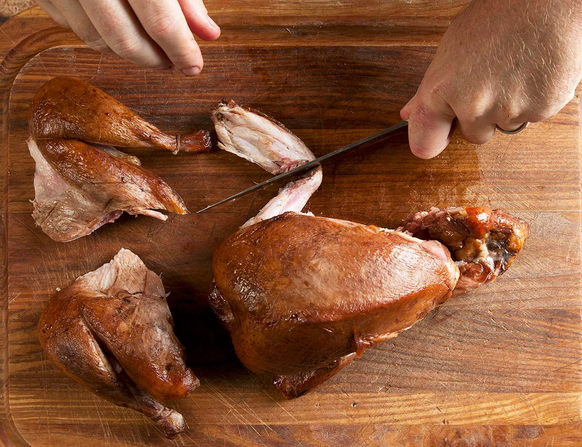 Carving a smoked pheasant