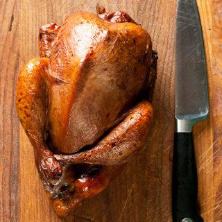 smoked pheasant on cutting board