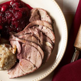 Roast venison leg with dumplings and cranberry sauce