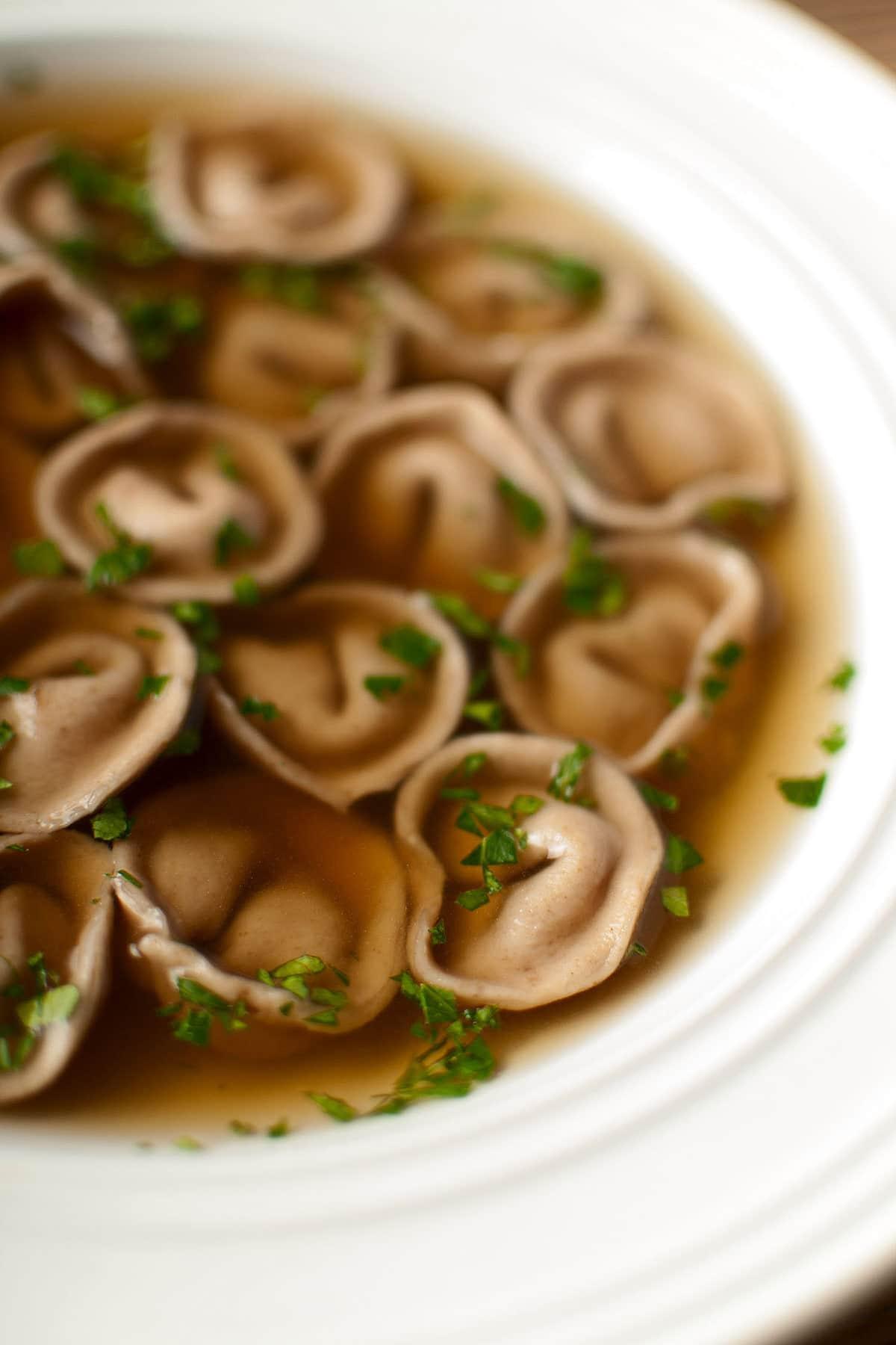 Closeup of a bowl of cappelletti pasta en brodo
