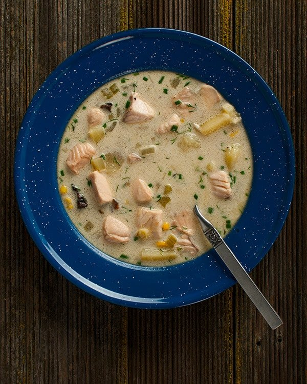 salmon chowder in a bowl, ready to eat.