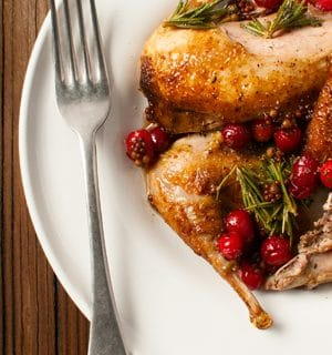 Seared partridges with cranberries and rosemary.