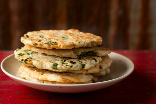 A stack of scallion pancakes on a plate