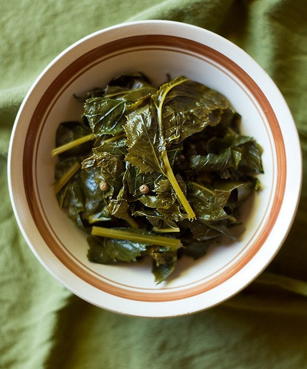 A bowl of pickled mustard greens