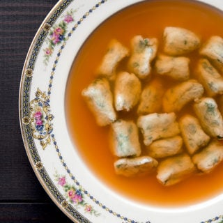 carrot consomme with dumplings in a bowl