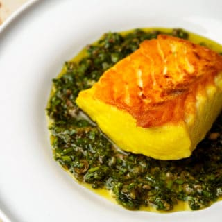Italian salsa verde with halibut on a plate