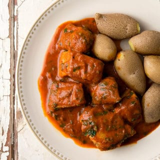Tuna with red pepper sauce and potatoes