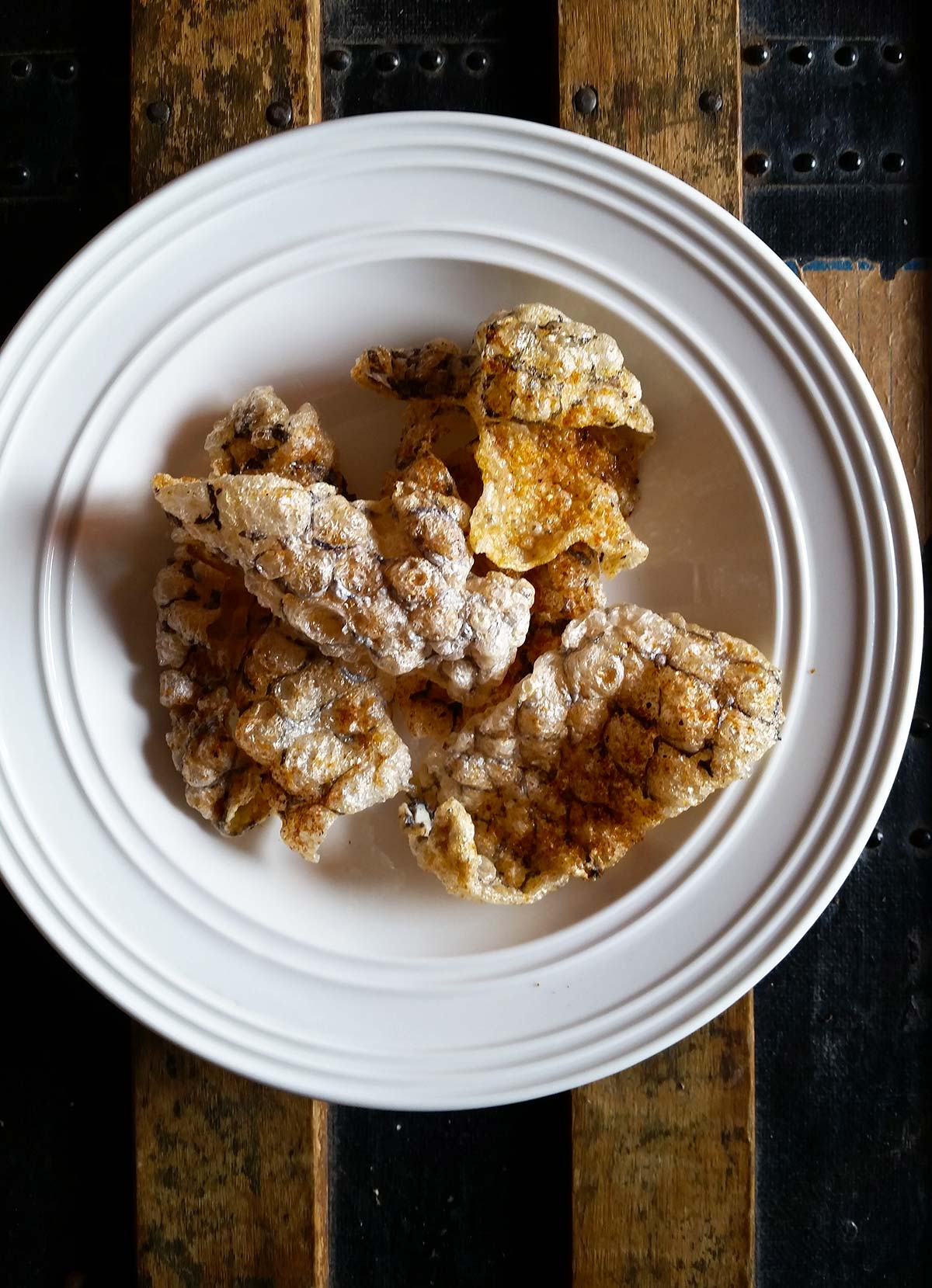 Tripletail fish skin chips in a bowl