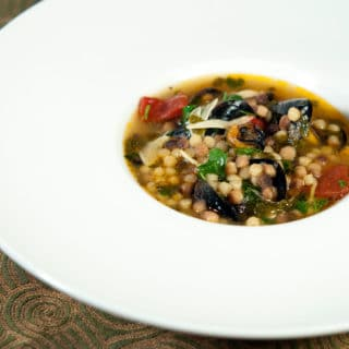 A bowl of Sardinian soup with mussels and clams
