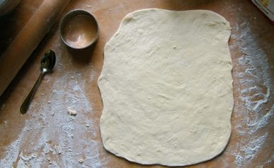 Rolled out pierogi dough.