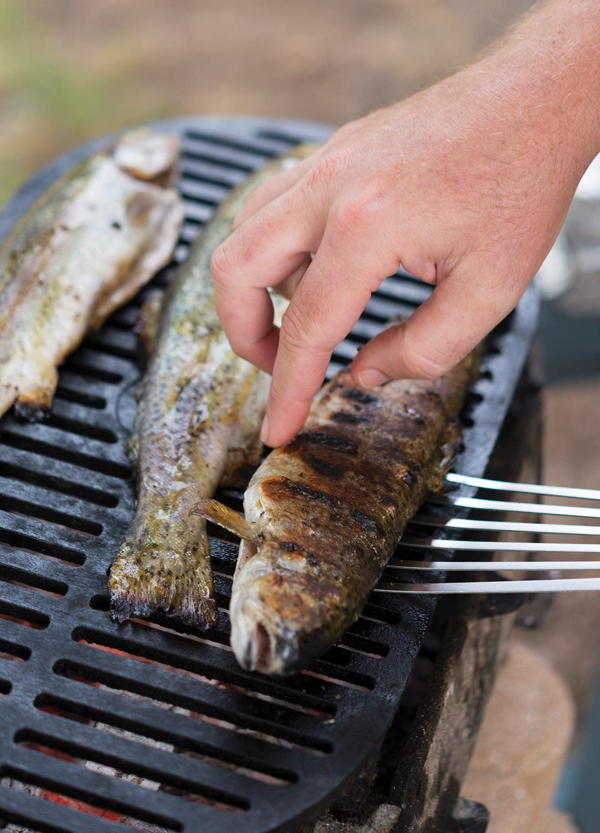 Flipping a grilled trout