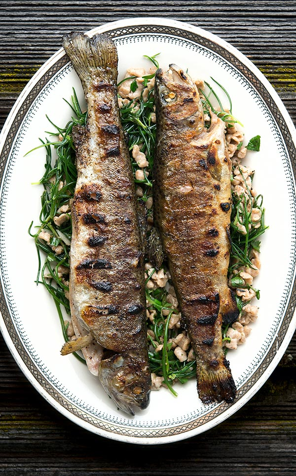Finished grilled trout on platter