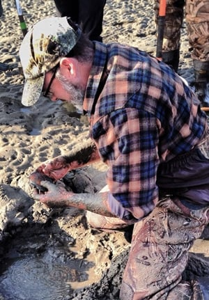 Hank Shaw, digging a clam