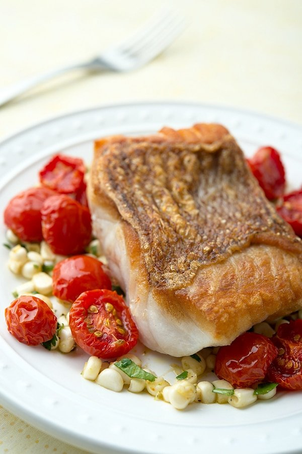 Closeup of red snapper with cherry tomatoes