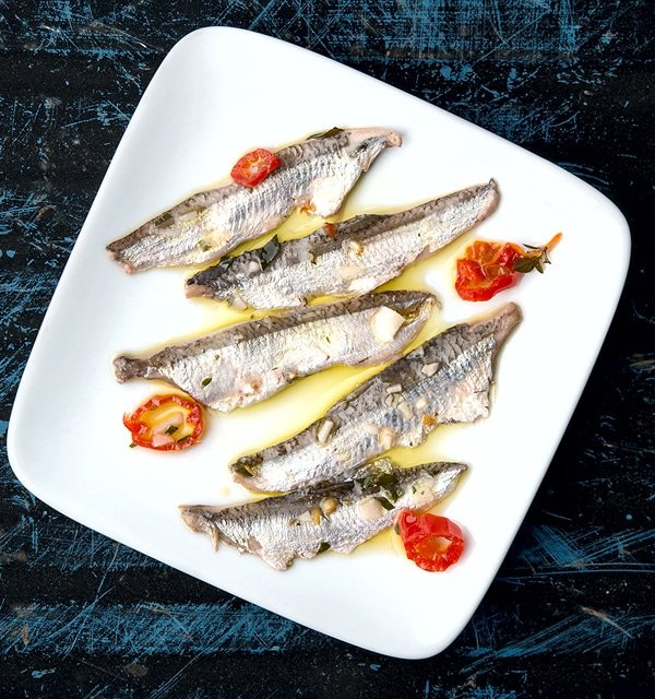 finished boquerones recipe, with fish on a plate