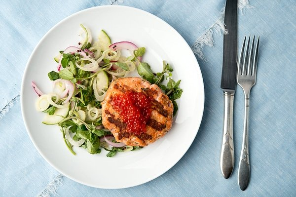 Fresh salmon patties grilled with a summer salad