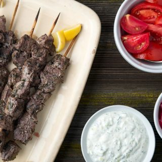 A platter of venison souvlaki with all the fixins.