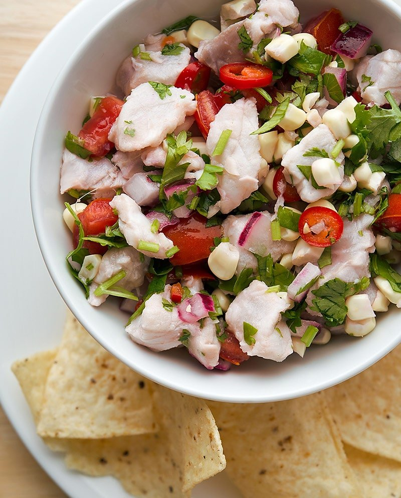 Basic ceviche recipe in a bowl with tortillas.