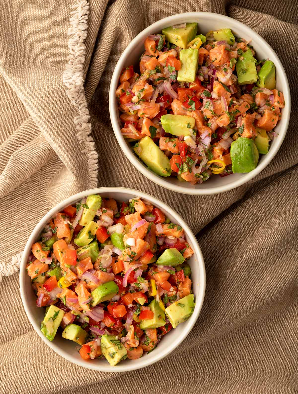 Two bowls of salmon ceviche
