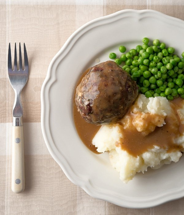 British meatballs with mashed potatoes and peas