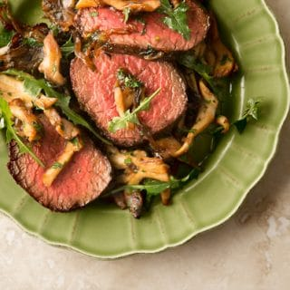 venison steaks with caramelized onions and mushrooms