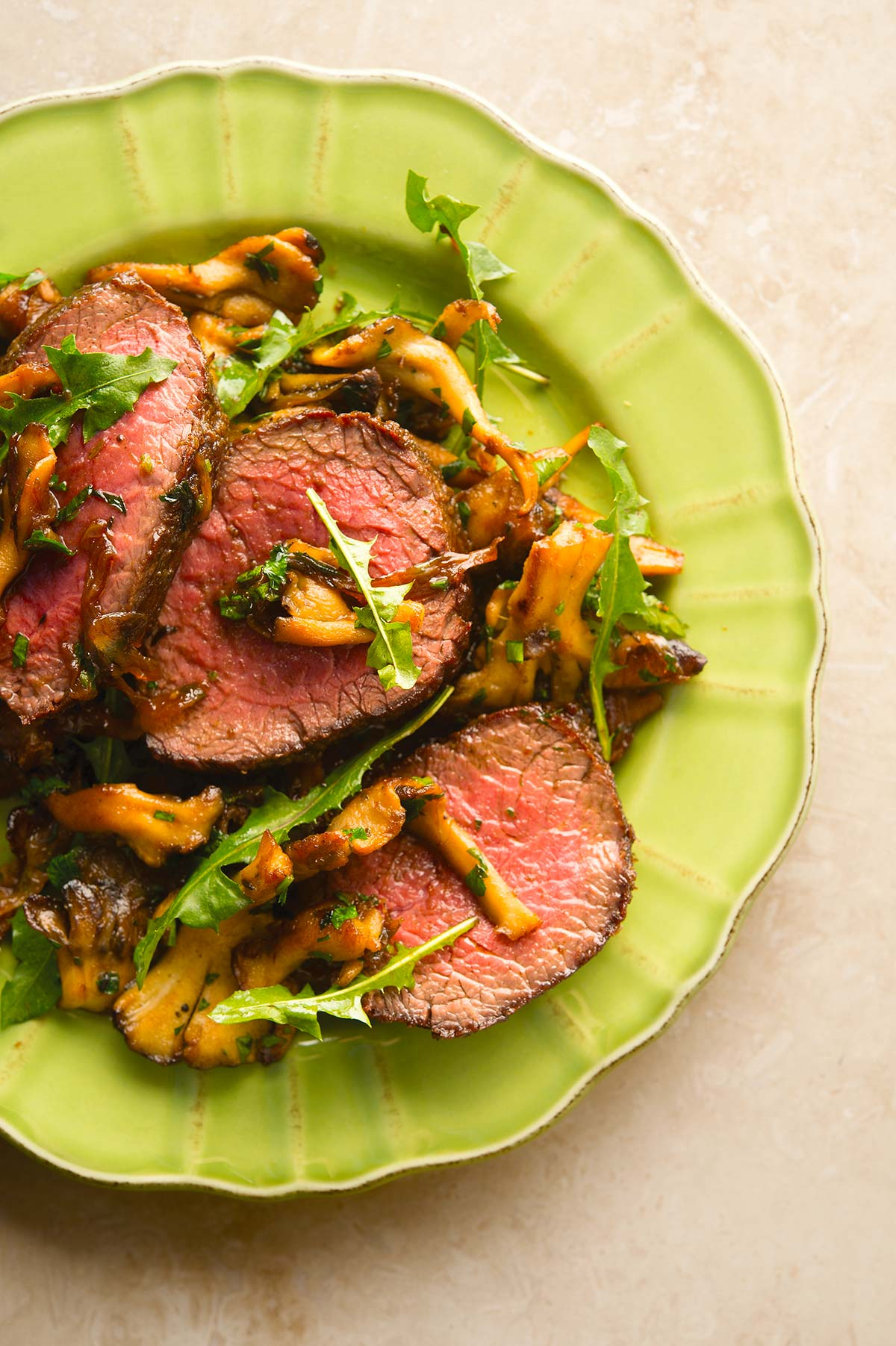 Venison steak with caramelized onions on a plate
