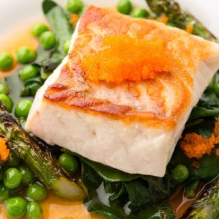 Closeup of seared fish and asparagus