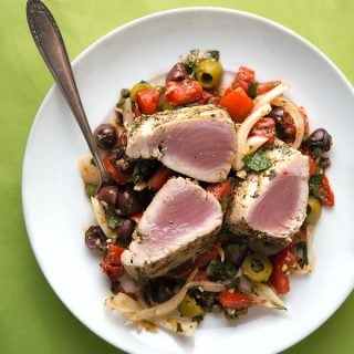 Grilled tuna with Sicilian salad on a plate
